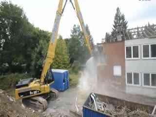 钩机视频大全 挖掘机工作视频表演 钩机装车视频轮呔挖掘机在挖袋装
