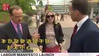 """BBC记者现场直播遭美女抢镜_伸手推开误袭胸遭""""殴打"""""""
